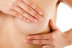 woman-examining-her-breast-isolated-on-white